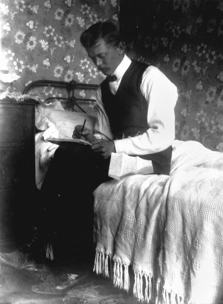 StateLibQld_2_171951_Intimate_portrait_of_a_man_writing_a_letter,_1900-1910